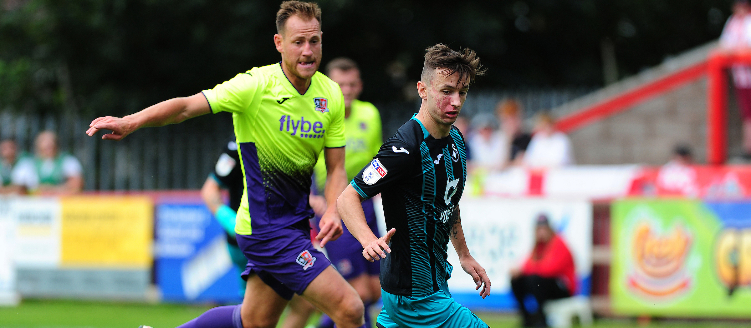 Bersant Celina holds off an Exeter challenge