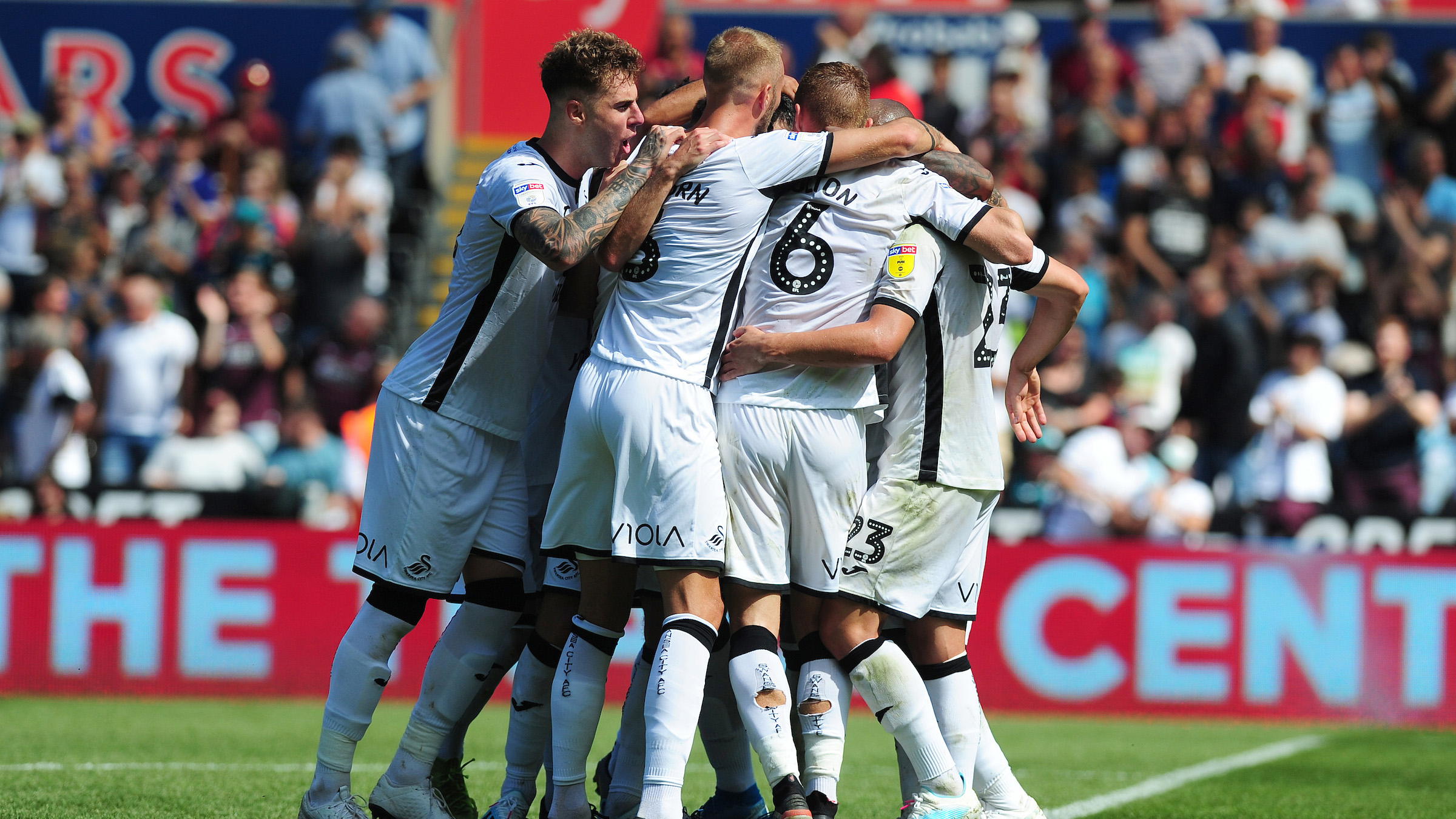 The Swans squad celebrate a goal