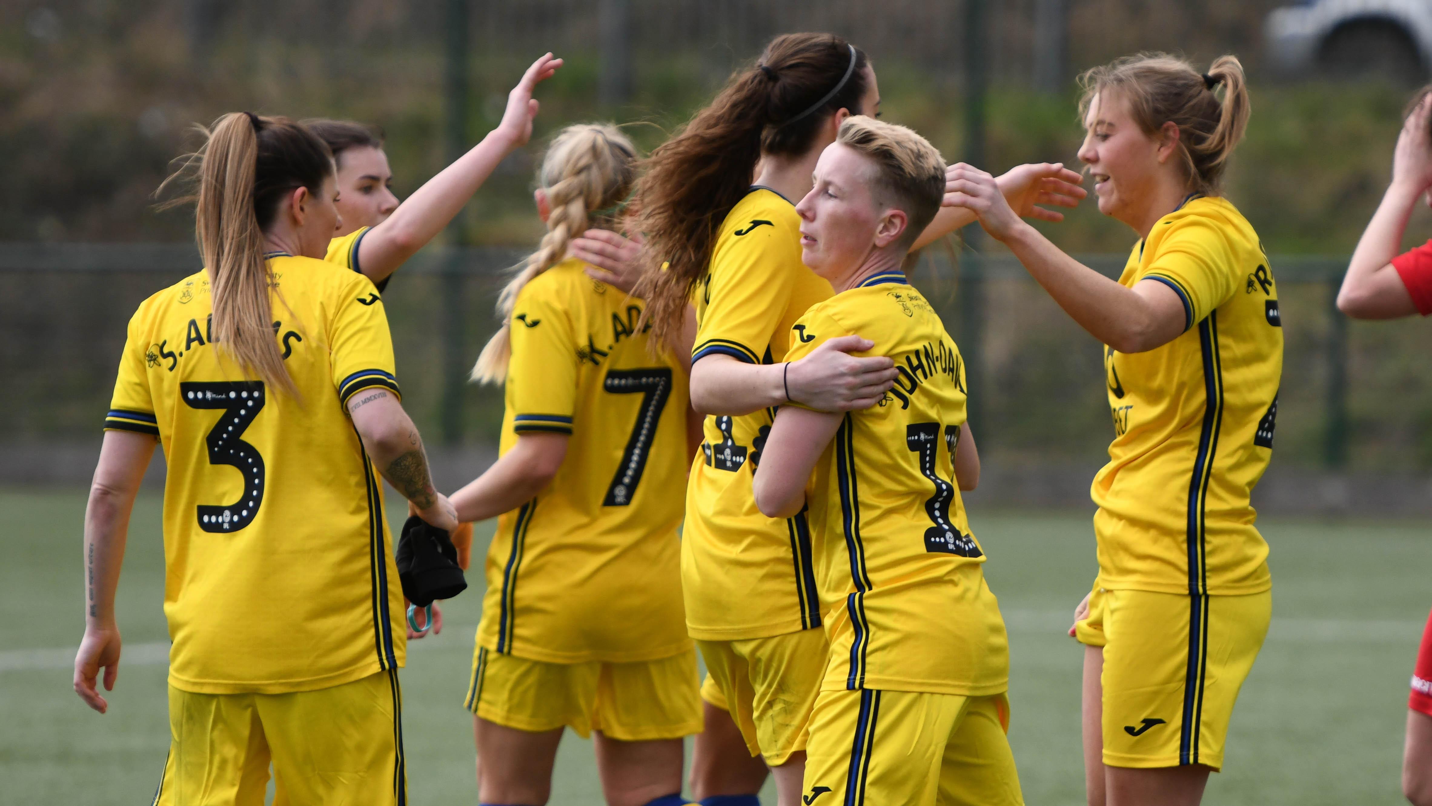 Swansea City Ladies celebrate a goal